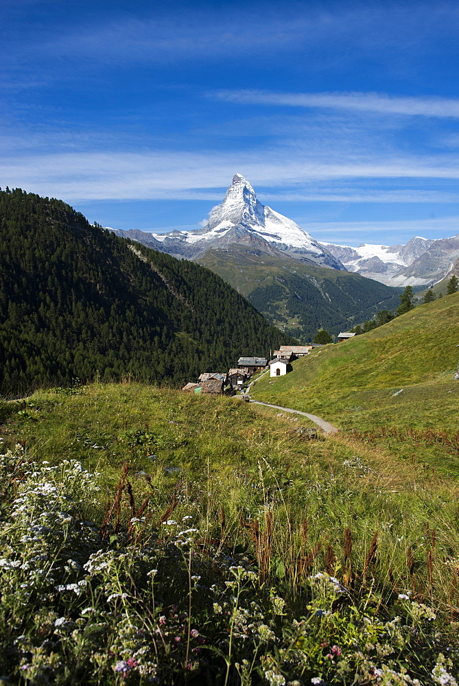 The classic Walkers Haute route from Chamonix to Zermatt the trail leads down into Zermatt with the Matterhorn ahead,  Swiss Alps, Switzerland, Europe - 1225-1277