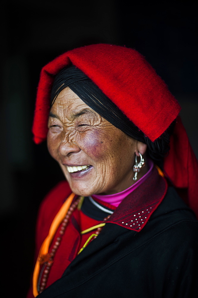 An Chinese Ngawa woman wearing traditionally bright dress in Songpa, Sichuan, China, Asia