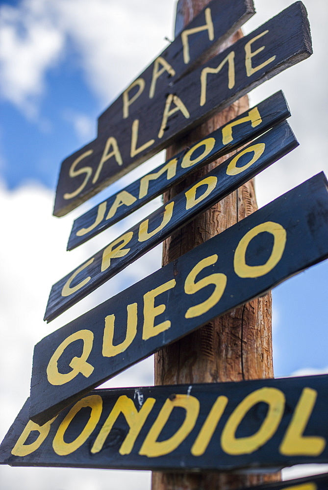 A sign outisde a cafe in Patagonia advertises the menu in Spanish, Argentina, South America