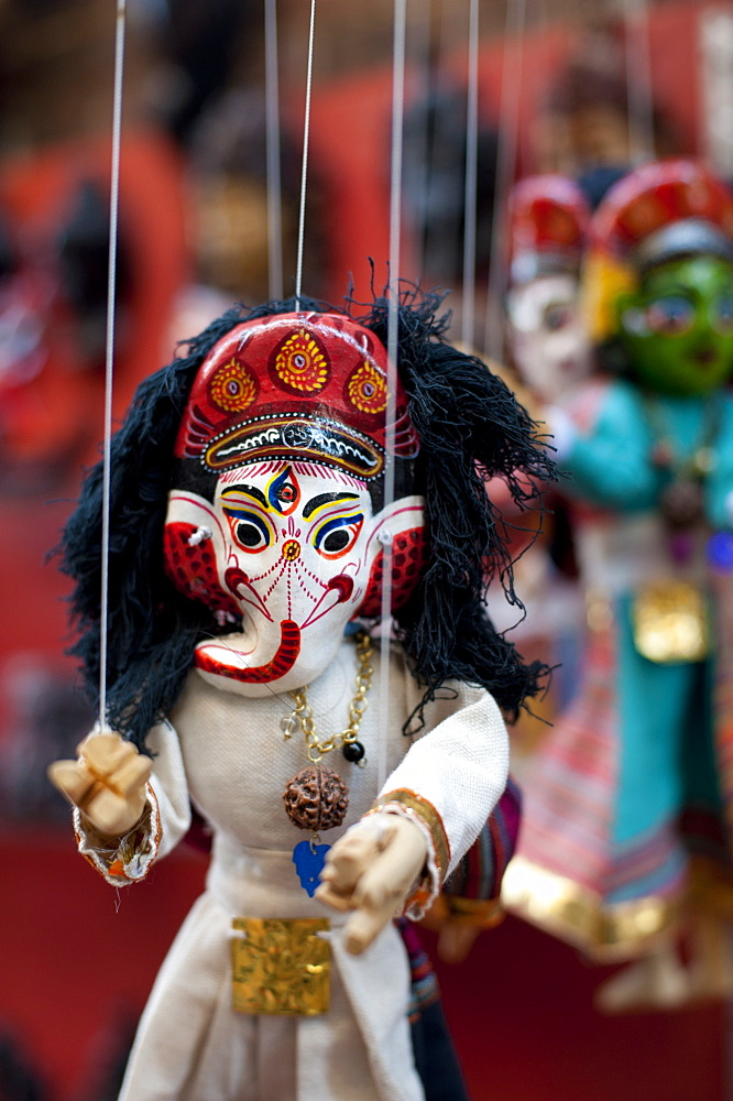 Colourful puppets hanging on display in the historical Newar city of Bhaktapur, Nepal, Asia