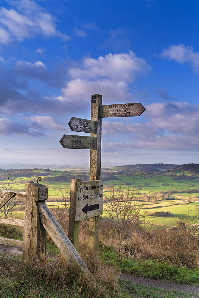 Signpost and distant view of the Vale of York from Whitestone Cliff, North Yorkshire Moors, Yorkshire, England, United Kingdom, Europe - 1228-160