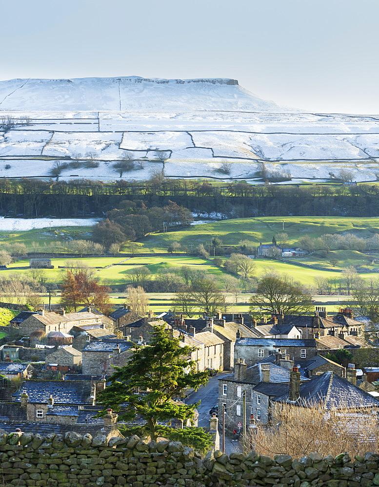 Askrigg village and snow capped Addlebrough in upper Wensleydale, The Yorkshire Dales, UK. - 1228-240