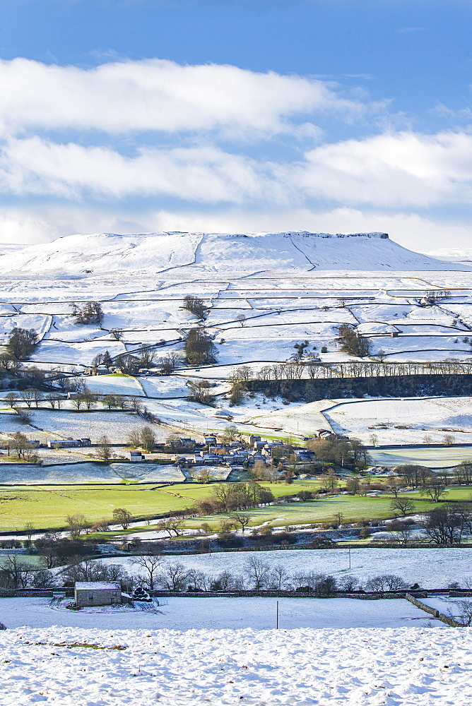 Fresh snow and winter sunshine covering the fell tops in Wensleydale around Nappa Scar and Addlebrough, North Yorkshire, UK.