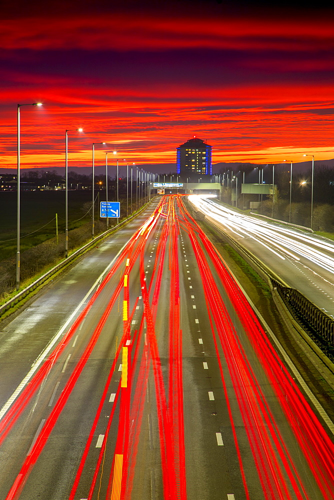 Red sky sunset, traffic light trails, M8 Motorway, Scotland, United Kingdom, Europe - 1237-344