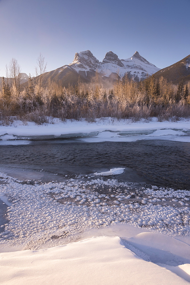 Winter sunrise with frozen Bow River and Three Sisters, Canmore, Alberta, Canadian Rockies, Canada, North America - 1241-170