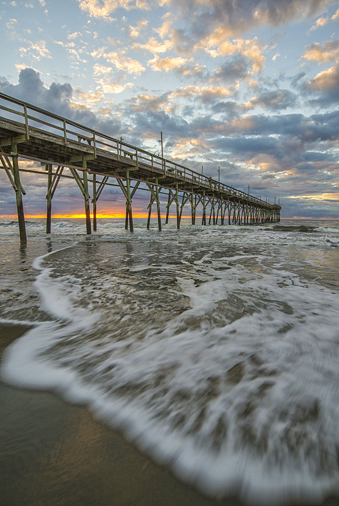 Beach, ocean, waves and pier at sunrise, Sunset Beach, North Carolina, United States of America, North America