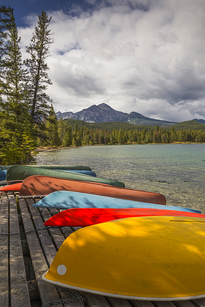 Colourful canoes and kayaks on the bank of Annette Lake with Pyramid Mountain in the background, Jasper National Park, UNESCO World Heritage Site, Canadian Rockies, Alberta, Canada, North America - 1241-83
