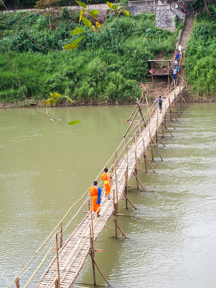 Orange-clad Buddhist monks crossing a bamboo bridge, Luang Prabang, Laos, Indochina, Southeast Asia, Asia - 1242-218