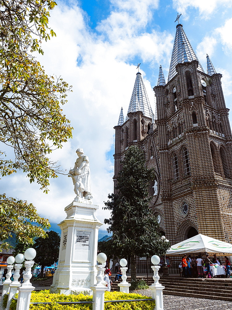 Basilica Menor de la Immaculada Concepcion faces the Parque Principal and a monument to women, Jardin, Colombia, South America