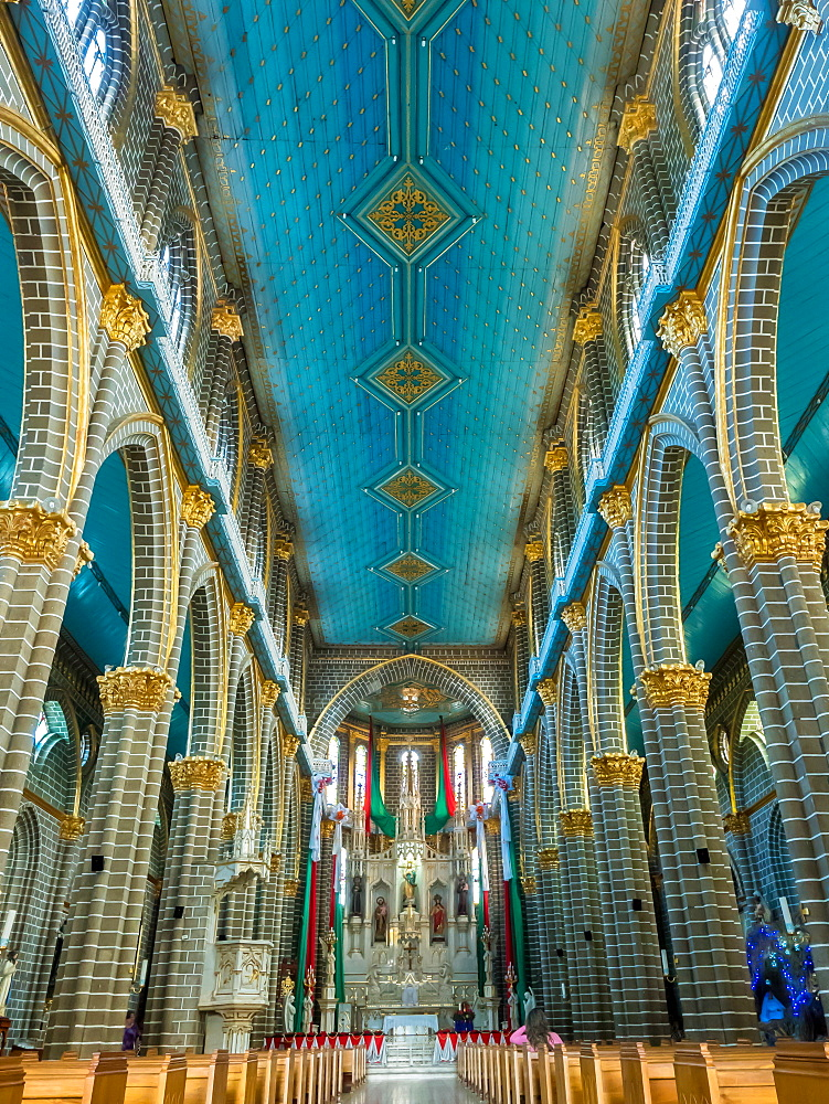 Blue and gold interior of the Basilica Menor de la Immaculada Concepcion, Jardin, Antioquia, Colombia, South America