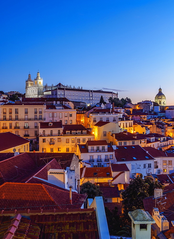 Miradouro das Portas do Sol, twilight view over Alfama Neighbourhood towards the Sao Vicente de Fora Monastery, Lisbon, Portugal, Europe