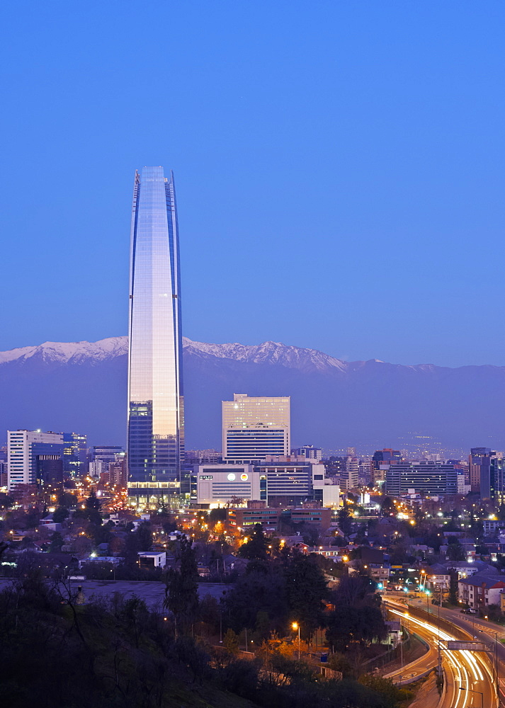 Twilight view from the Parque Metropolitano towards the high raised buildings with Costanera Center Tower, Santiago, Chile, South America