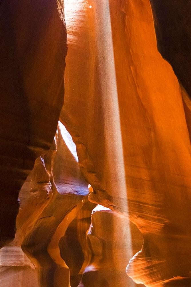 Ray of light through Upper Antelope Canyon, Navajo Tribal Park, Arizona, Usa.