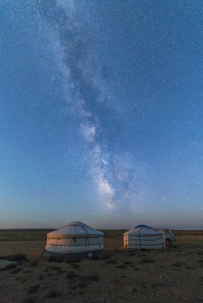Mongolian traditional gers under the Milky Way, Ulziit, Middle Gobi province, Mongolia, Central Asia, Asia