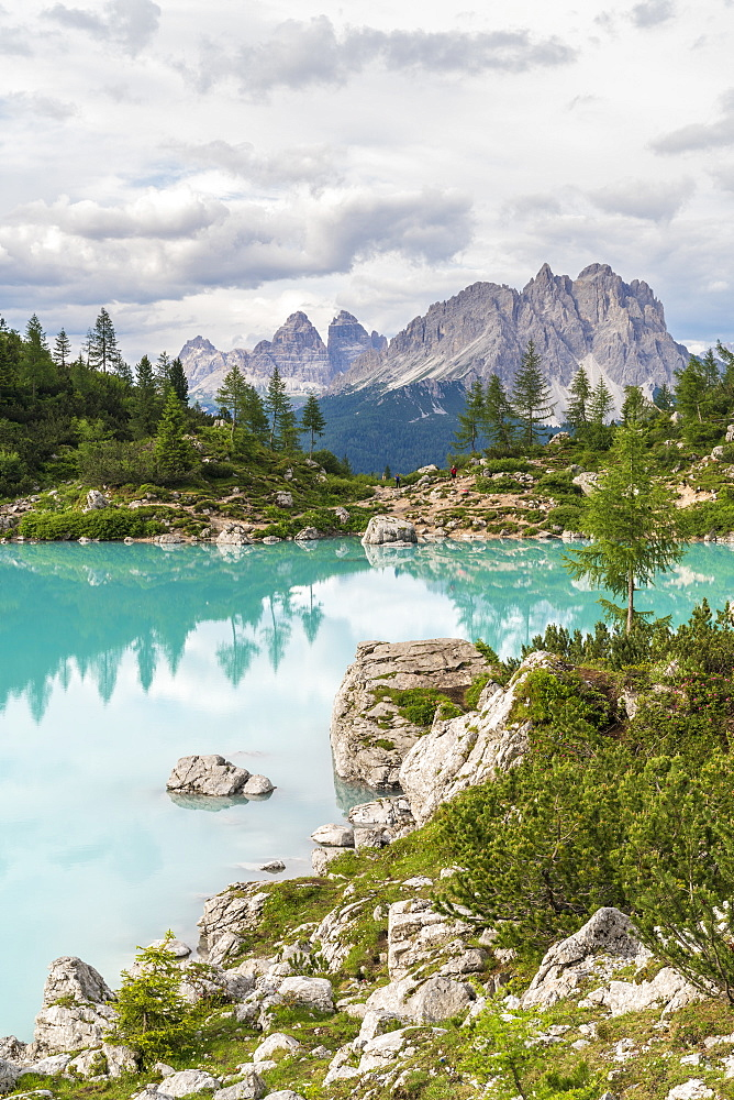 Sorapis Lake and the Three Peaks of Lavaredo and Cadini di Misurina in the background, in summer. Cortina d'Ampezzo, Belluno province, Veneto, Italy.