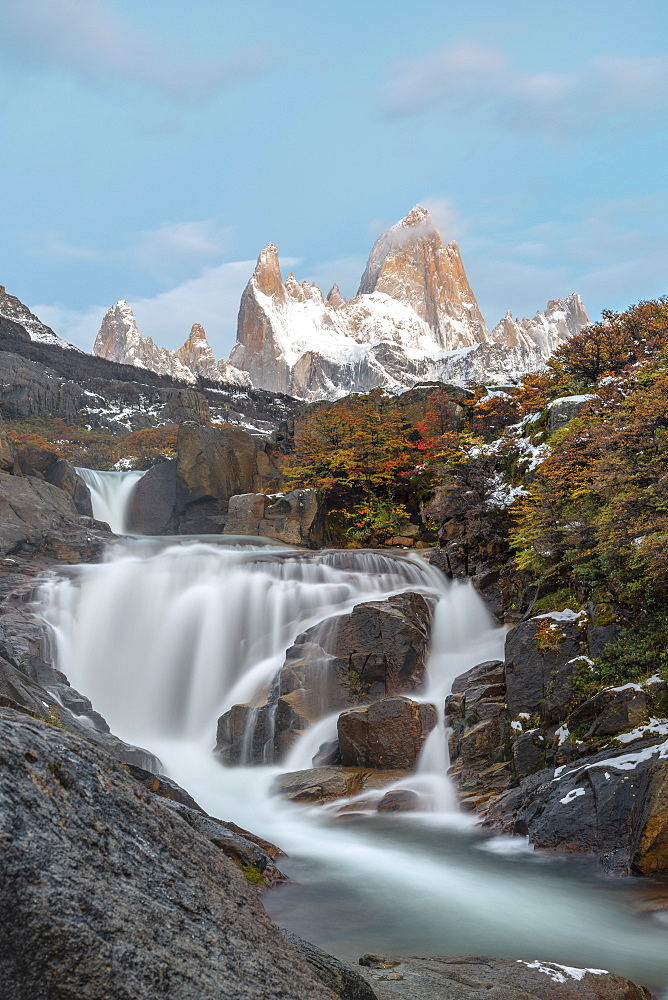 Secret waterfall and Fitz Roy at sunrise, El Chalten, Los Glaciares National Park, UNESCO World Heritage Site, Santa Cruz province, Argentina, South America