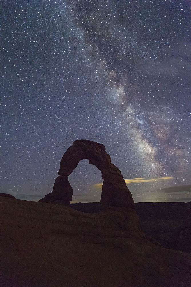 Milky Way above Delicate Arch. Arches National Park, Moab, Grand County, Utah, USA.