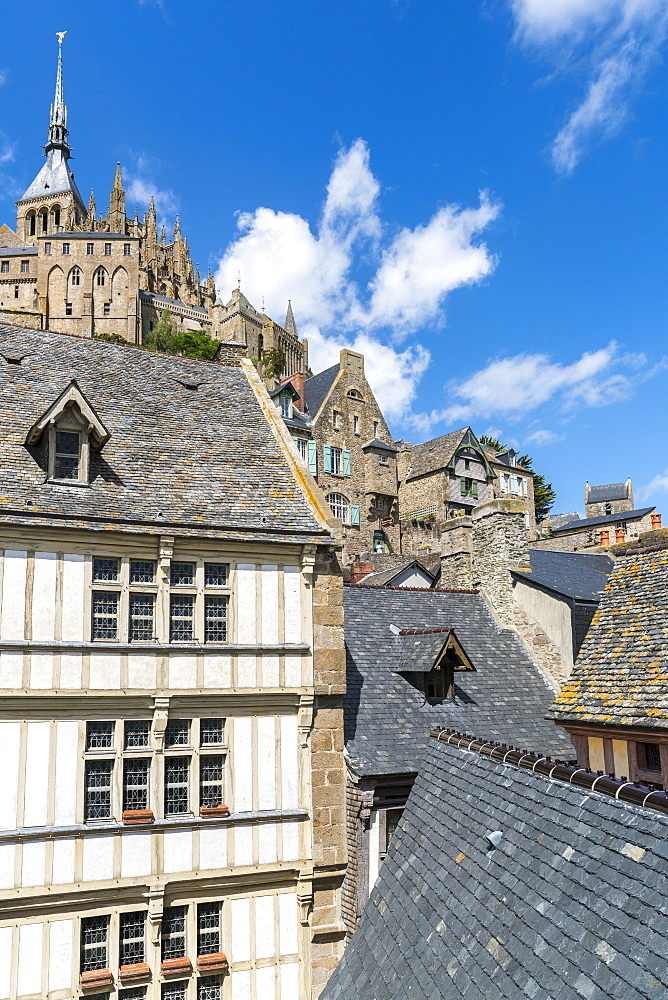 Houses in the village centre with the abbey above. Mont-Saint-Michel, Normandy, France.