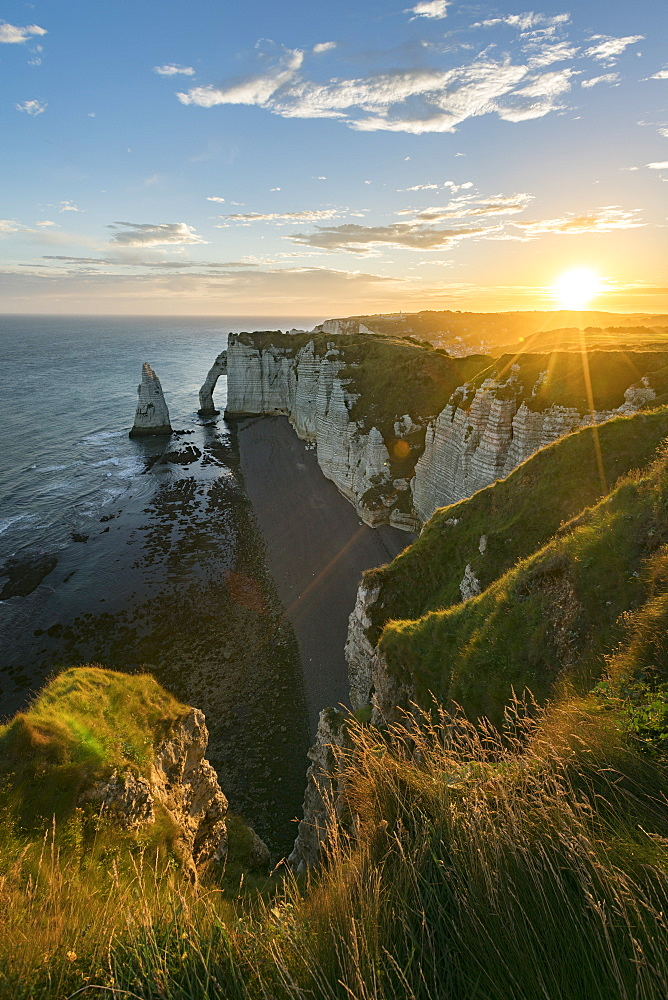 Sun rays at dawn at the cliffs, Etretat, Normandy, France, Europe