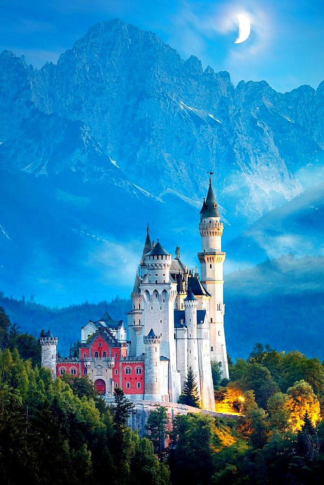 Original view of world-famous Neuschwanstein Castle at night with moon and fog, Germany, European landmark
