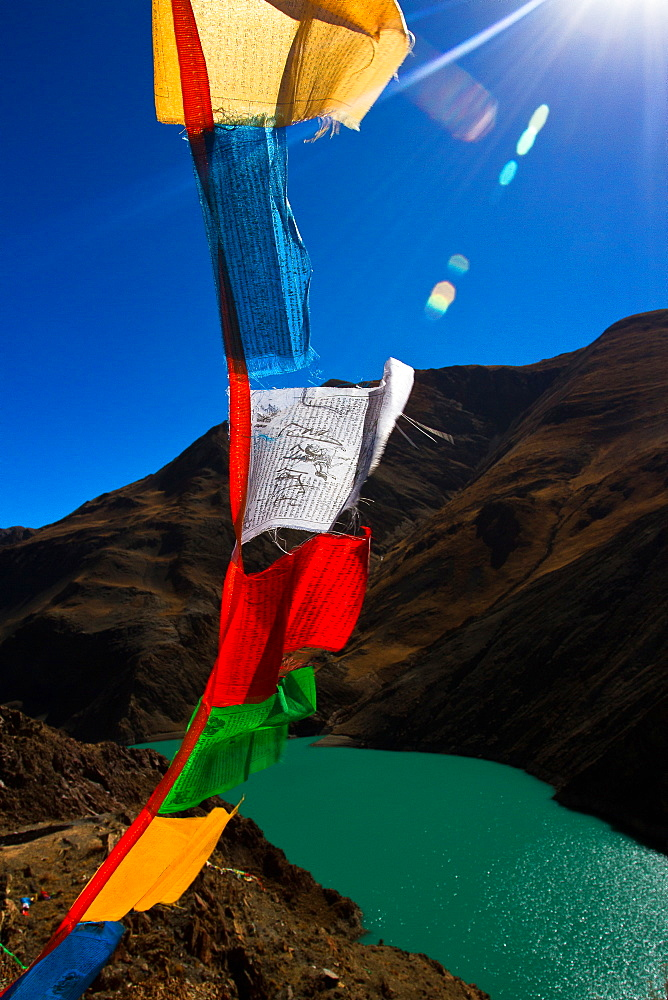 The Yamdrok Lake of Tibet with prayer flags, Tibet, China, Asia
