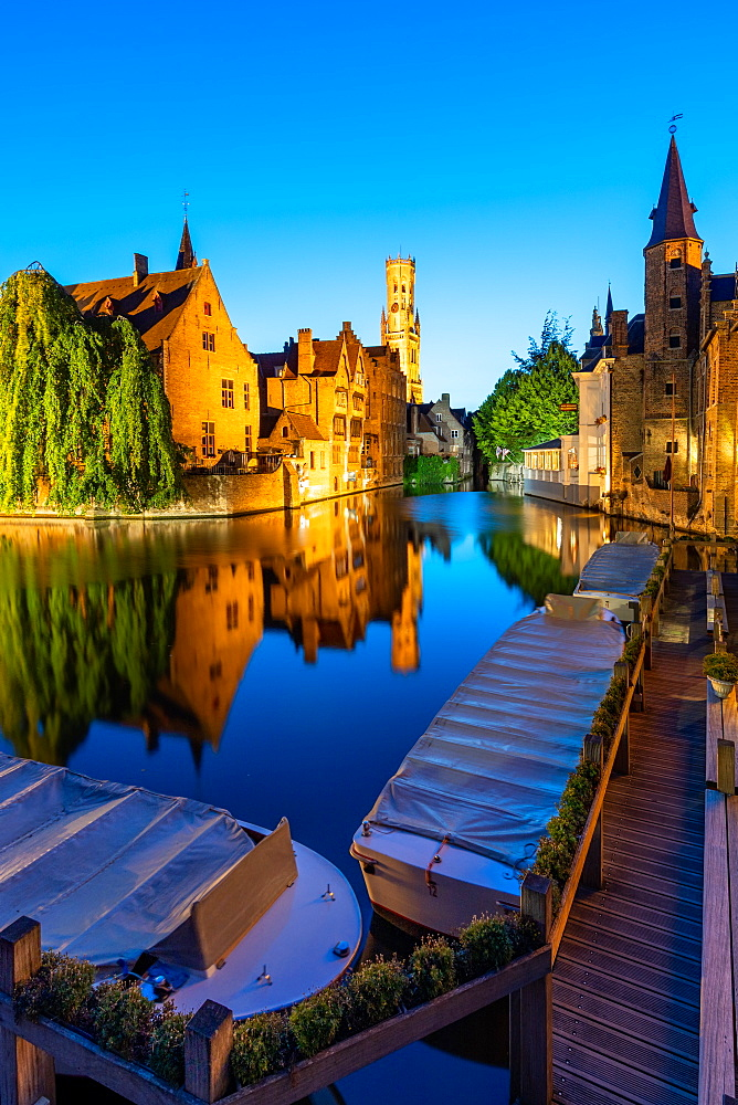 The beautiful buildings of Bruges reflected in the still waters of the canal, UNESCO World Heritage Site, Bruges, Belgium, Europe