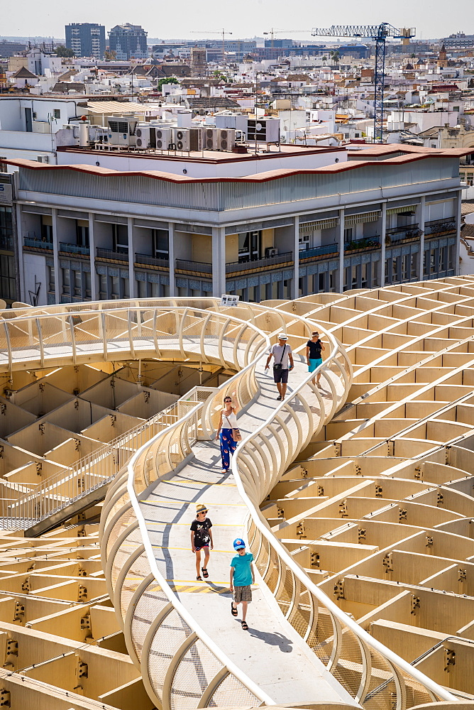 People on the elevated walking platform of Seville's Metropol Parasol, La Encarnación square, Seville, Sevilla, Spain
