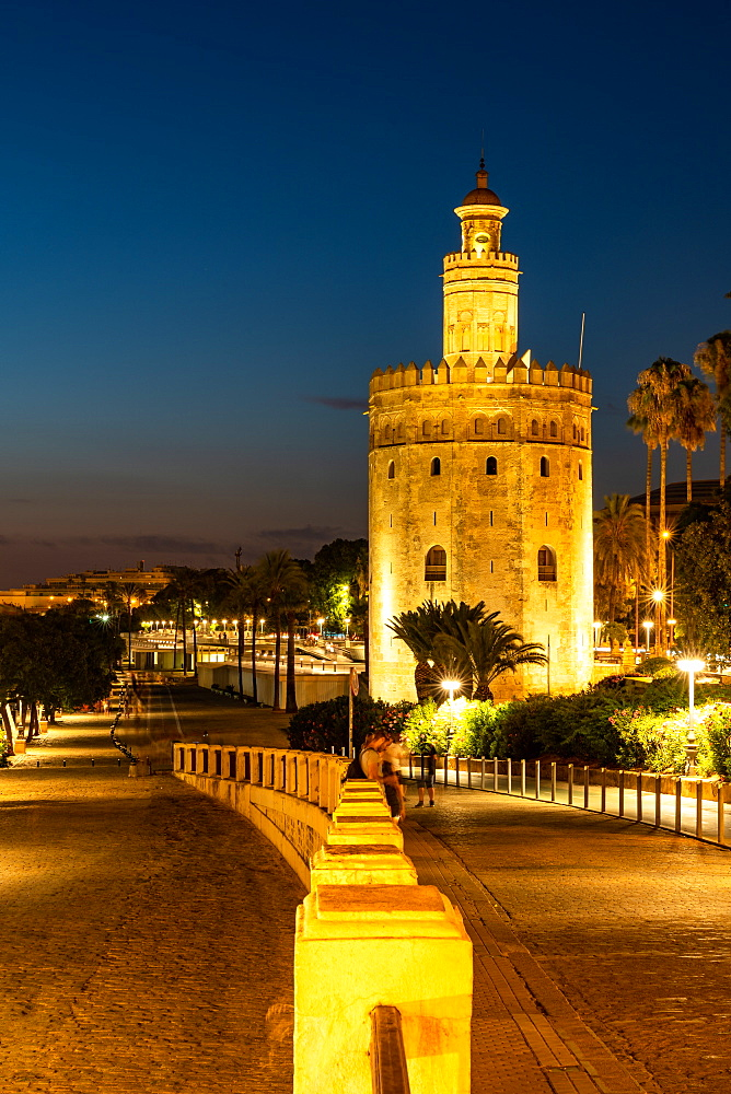 Sunset at Torre del Oro / Tower of Gold, a watchtower on the bank of the Guadalquivir river in Seville, Andalusia, Spain - 1263-233