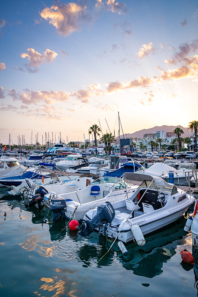 Boats at sunset at Benalmadena Puerto Marina between the Costa Del Sol beach resorts of Benalmadena and Torremolinos, Andalusia, Spain, Europe