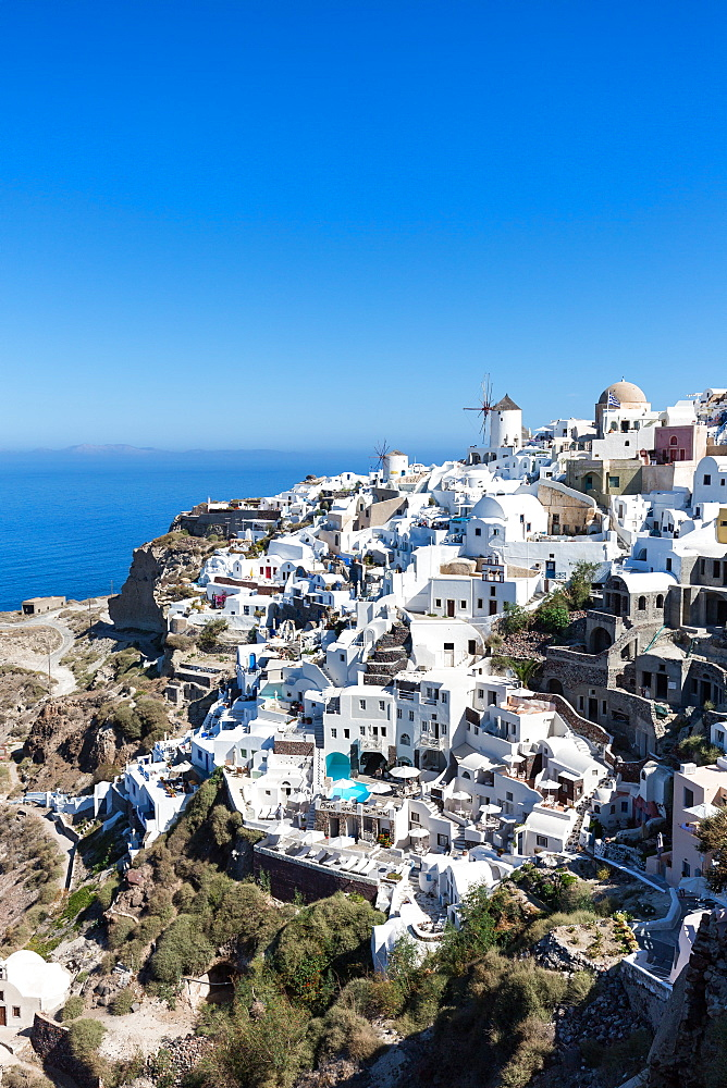 Day time view over the whitewashed buildings and windmill of Oia from the castle walls, Santorini, Cyclades, Greek Islands, Greece, Europe - 1263-45