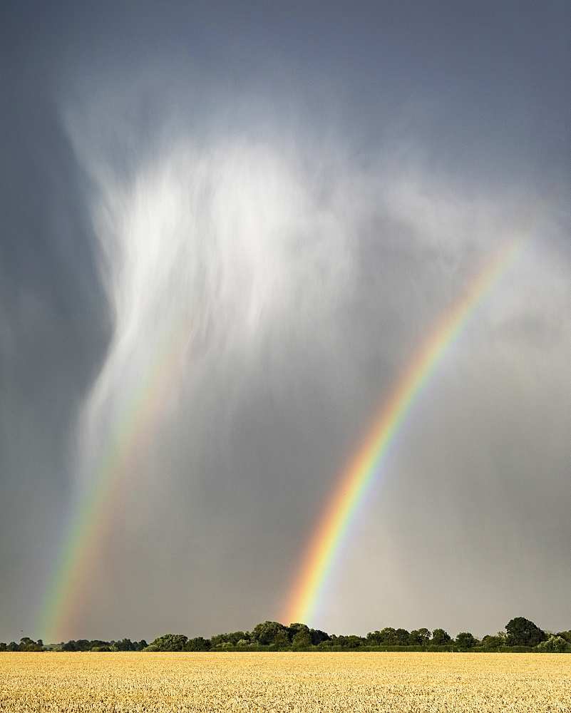 Summer storm clouds and stormy weather with a double rainbow near Lower Dunsforth, North Yorkshire, Yorkshire, England, United Kingdom, Europe