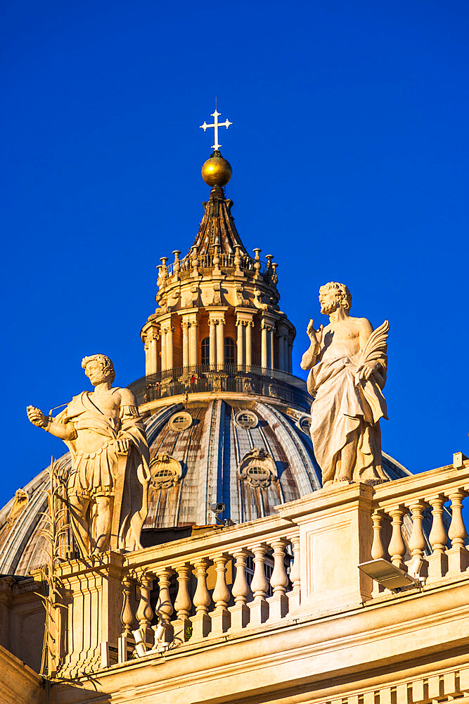 St. Peter's Basilica Cupola and statues in early morning light, Vatican City, UNESCO World Heritage Site, Rome, Lazio, Italy, Europe - 1267-259