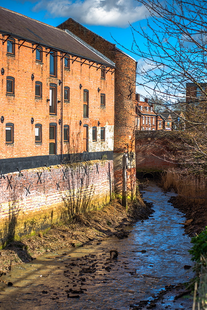 Victorian warehouses on river tributary in Kings Lynn, Norfolk, England, United Kingdom, Europe
