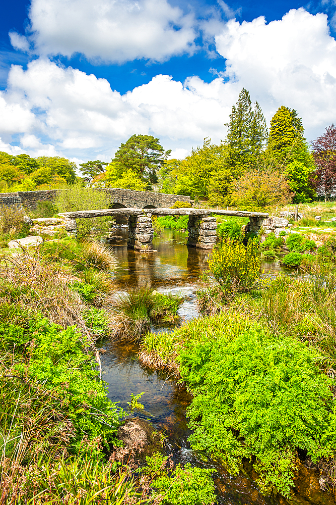 Medieval clapper bridge over the East Dart River at Postbridge on Dartmoor in Devon, West Country, England, UK