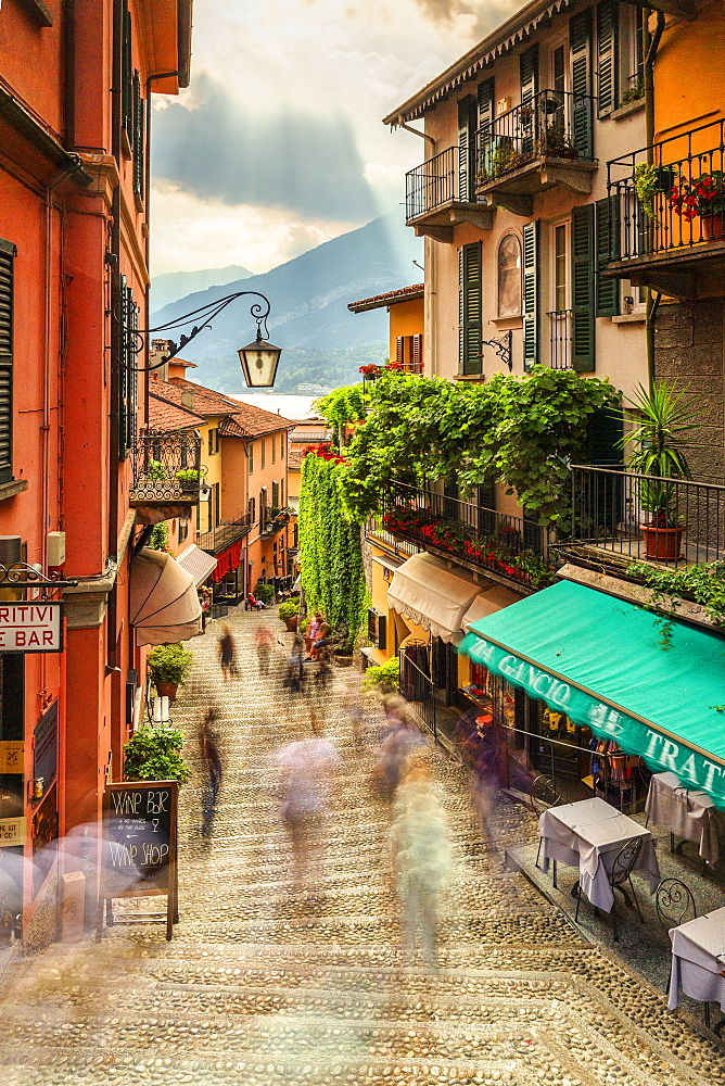 Tourists walk stairs in Bellagio, Province of Como, Lake Como, Italian Lakes, Lombardy, Italy, Europe