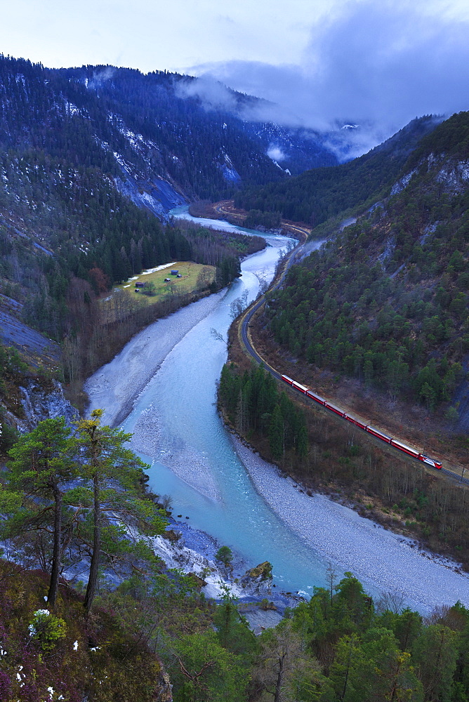 Transit of the Red Train in the gorge. Rhein Gorge(Ruinaulta), Flims, Imboden, Graubunden, Switzerland, Europe