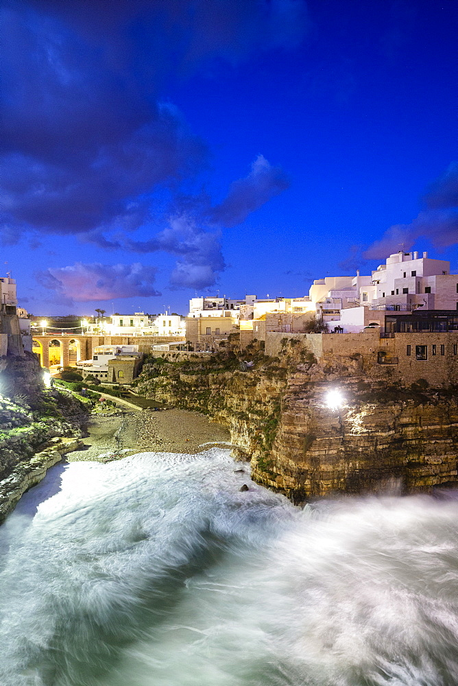 Waves crash on the beach during a winter storm, Polignano a Mare, Apulia, Italy, Europe