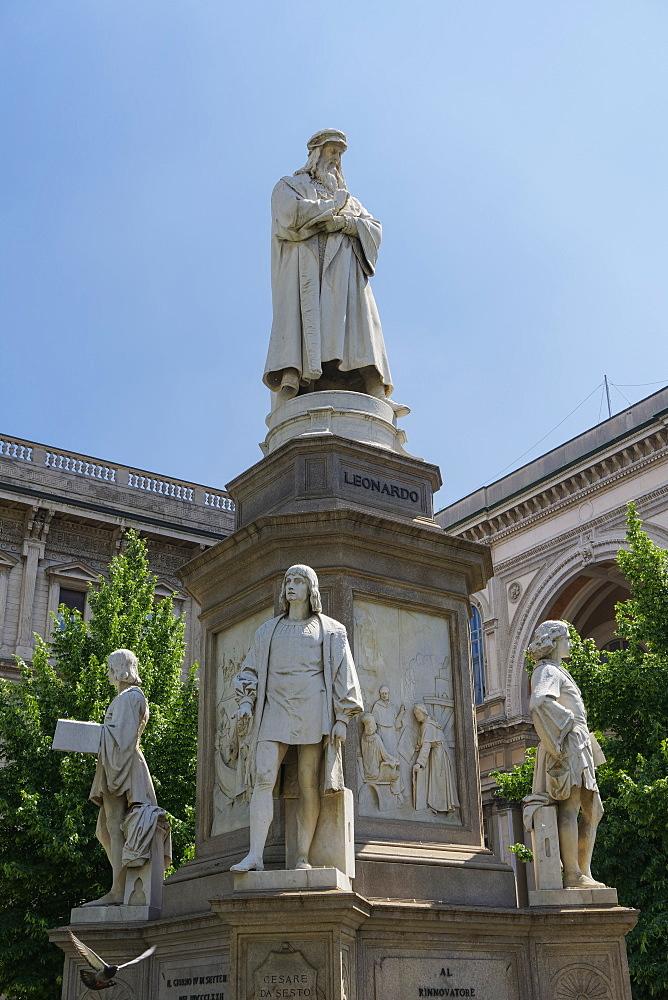 Milan, Italy Leonardo da Vinci statue. Day view of the scientist statue with his disciples at his feet in Piazza della Scala.