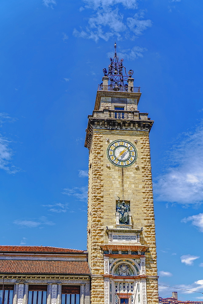 Day view of Torre dei Caduti with clock, 1924 historic stone Tower of The Fallen, at Piazza Vittorio Veneto, Bergamo, Lombardy, Italy, Europe