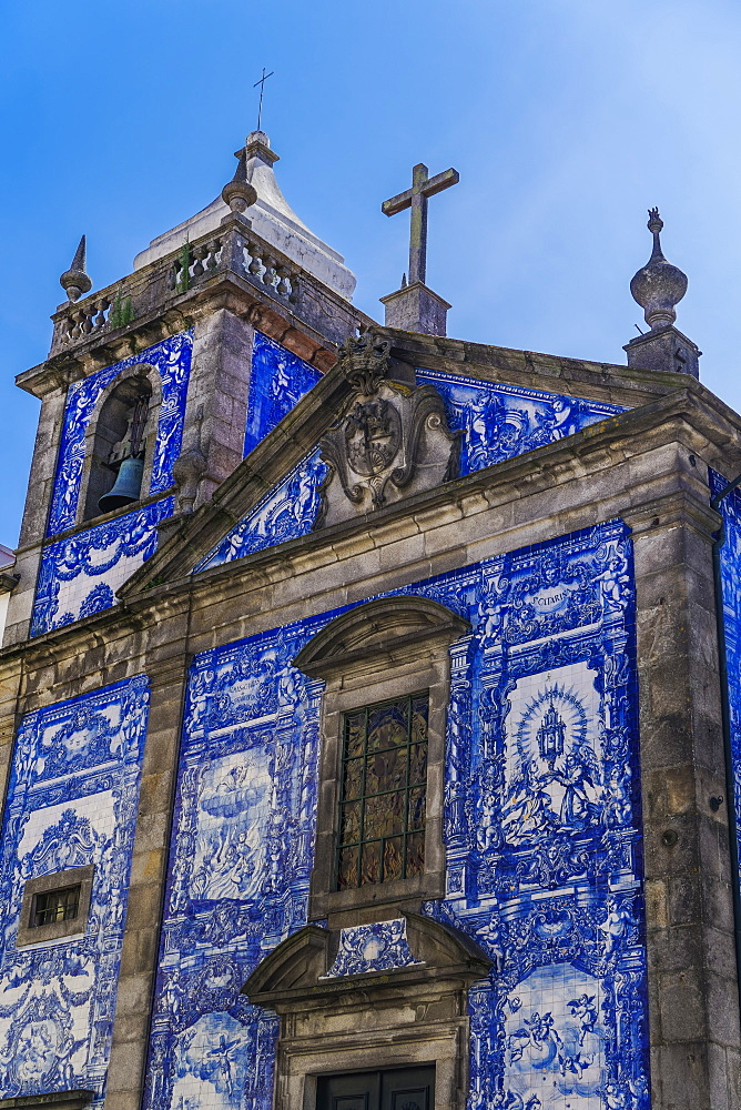 Facade of Chapel of Souls, covered with azulejo blue and white painted ceramic tiles, Capela das Almas Church, Porto, Portugal, Europe - 1278-175
