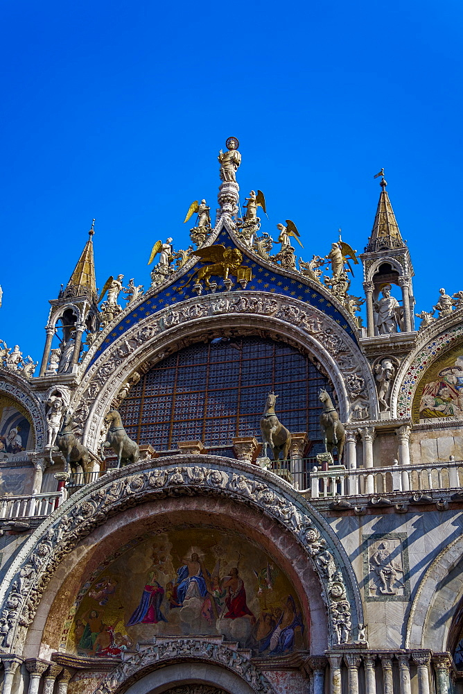 External day view detail of the gable of The Patriarchal Cathedral Basilica of Saint Mark at Piazza San Marco.