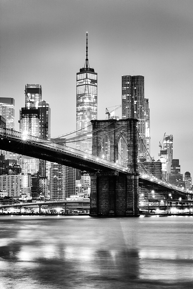 Brooklyn Bridge with 1 World Trade Centre in the background. New York City, New York, United States of America, North America