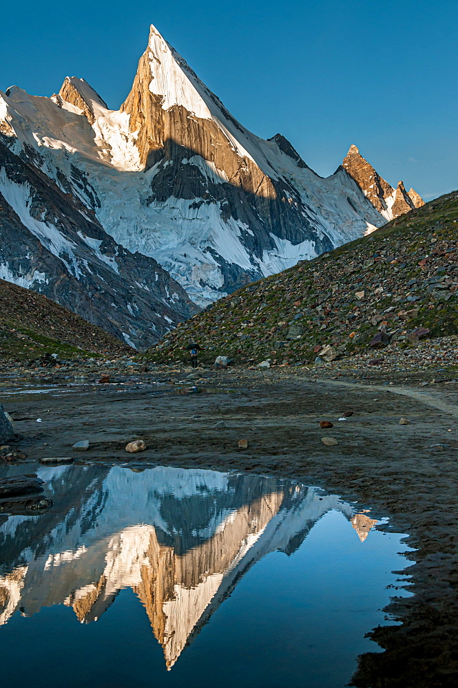Laila Peak in the Hushe Valley, Karakoram range in Gilgit-Baltistan, Pakistan, reflecting in small pond in the valley at sunrise - 1287-101