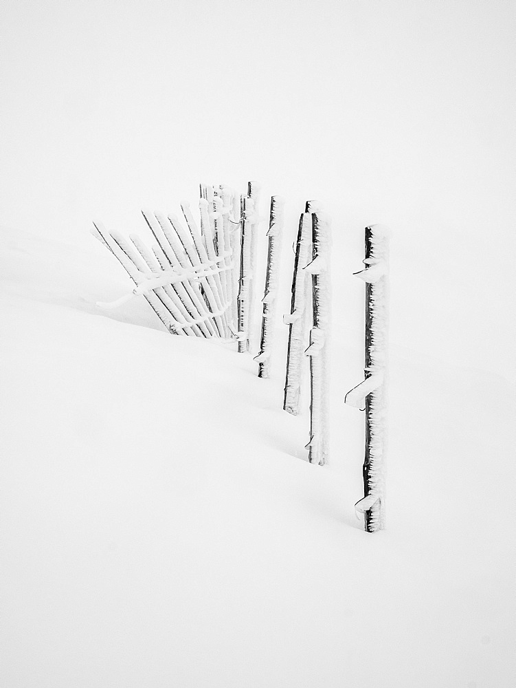 A build up of rime ice on the ski fence during a white out conditions on the Cairngorms, Scotland, United Kingdom, Europe - 1287-7