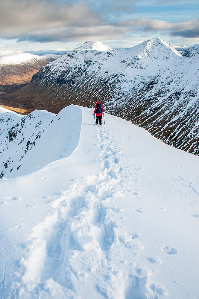 A female walker descending from the summit of Stob Dubh on Buchaille Etive Beag on a crisp winter day, Highlands, Scotland, United Kingdom, Europe - 1287-85