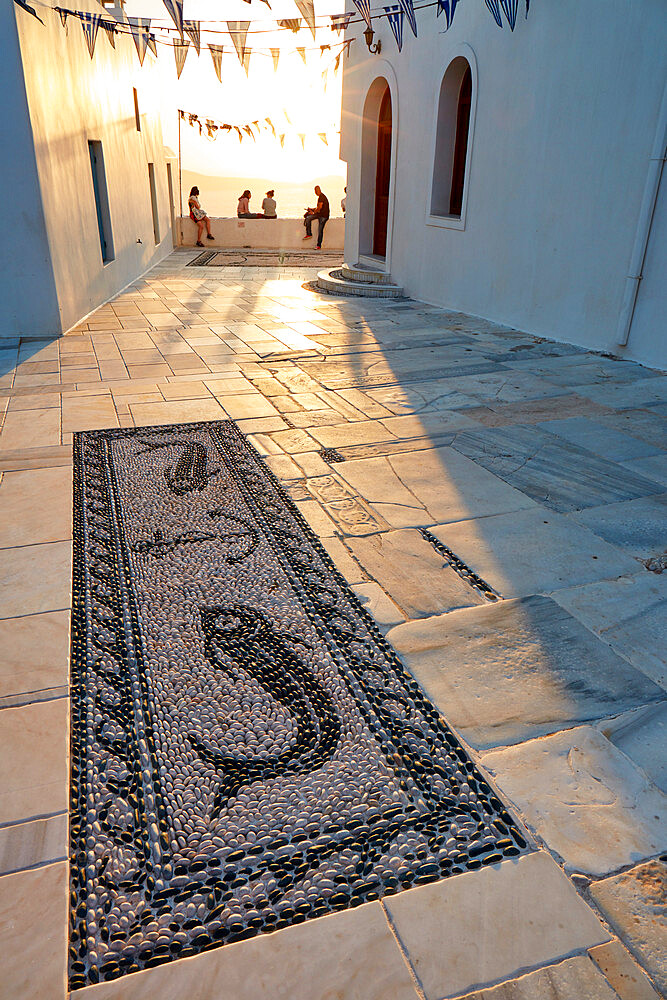 Sunset in Plaka, the main town on Milos, with Greek Orthodox feast decoration on the church square with pebble mosaic, Plaka, Milos, Cyclades, Greek Islands, Greece, Europe - 1294-175