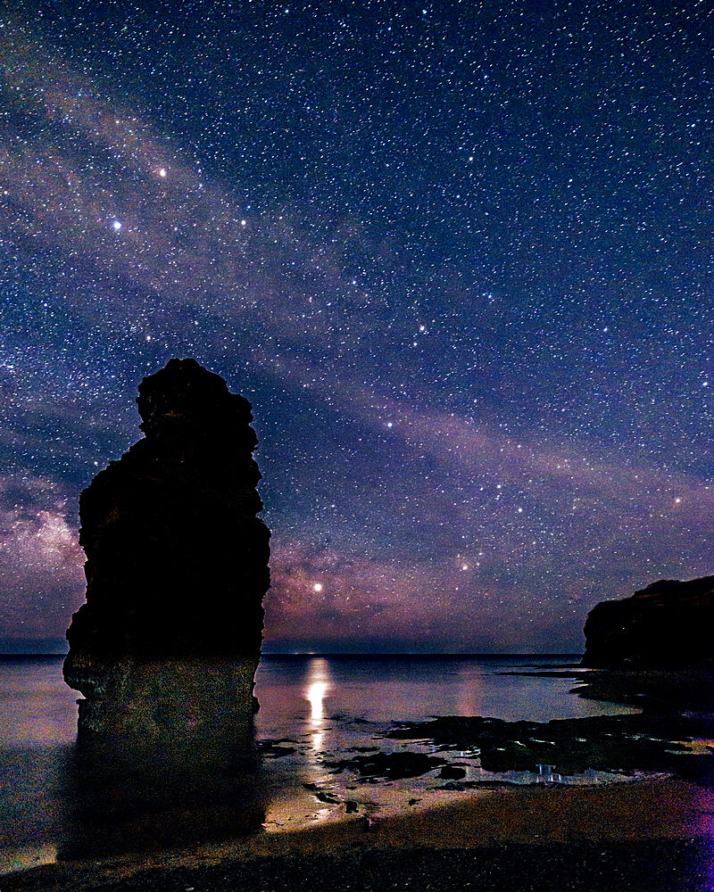 Milky Way and Jupiter beyond a majestic sea stack at Ladram Bay, Sidmouth, Devon, UK - 1295-227