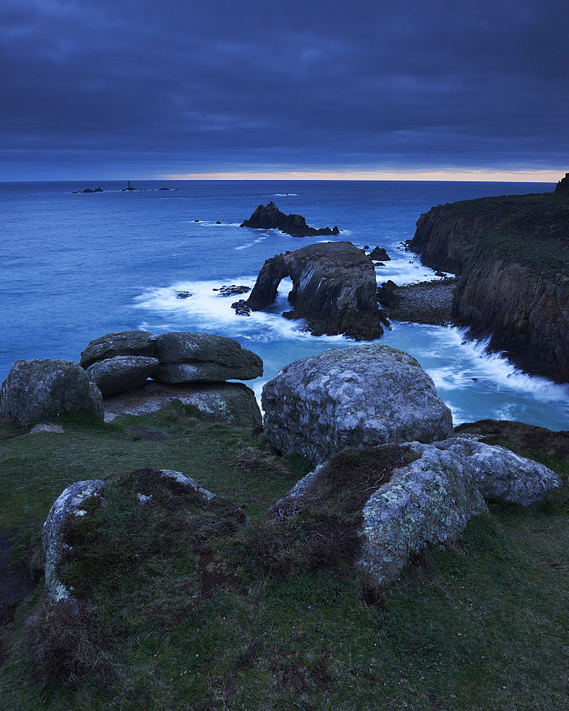 Sunset at Land's End over Enys Dodman rock arch, Longships Lighthouse, Cornwall, England, United Kingdom, Europe - 1295-263