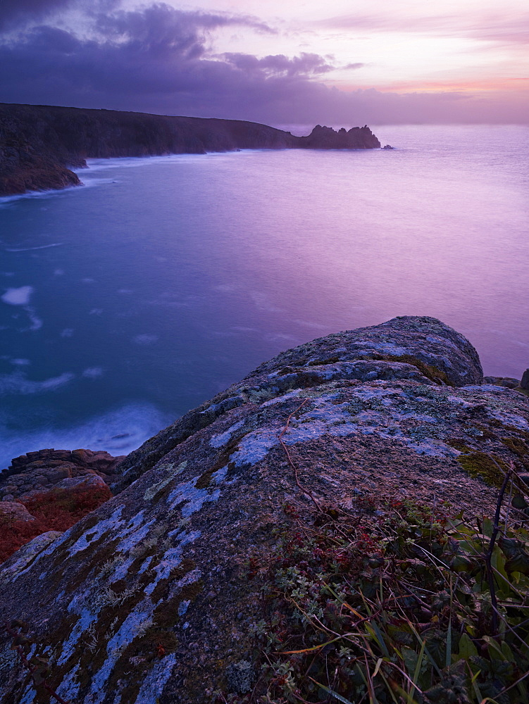 Sunrise from the Minack Theatre looking out towards Logan Rock at Porthcurno, Cornwall, UK