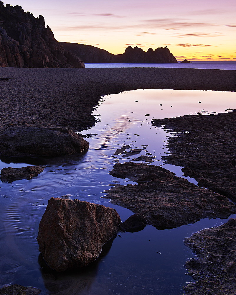 Early morning on the beach looking out towards Logan Rock at Porthcurno, Cornwall, England, United Kingdom, Europe - 1295-276